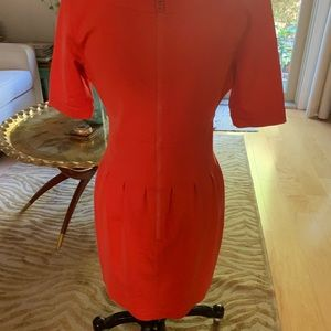 Pink Tartan Dresses - Orange red dress with exposed back zipper.
